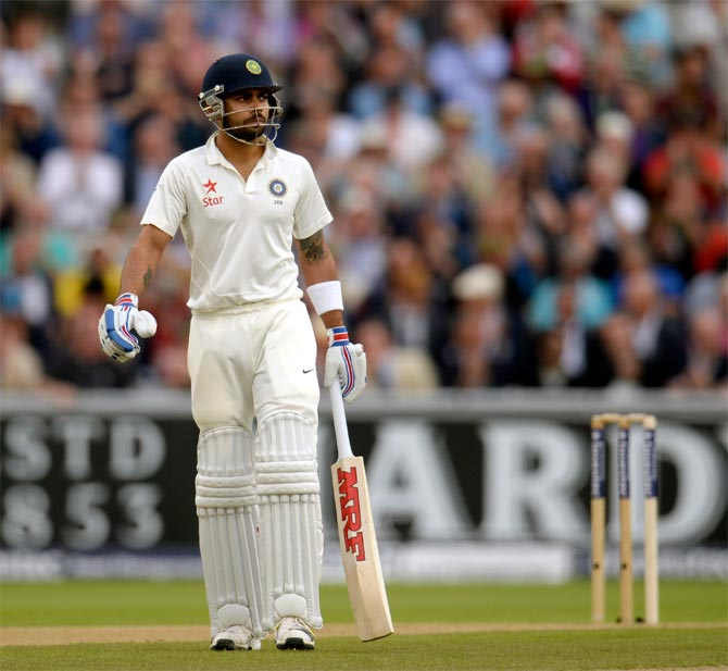 Virat Kohli leaves the field after being dismissed