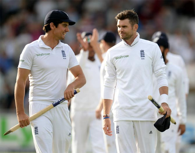 England's captain Alastair Cook (left) and James Anderson leave the field after winning the fourth Test match