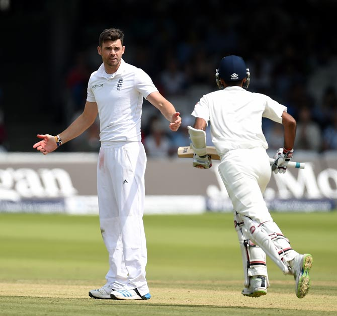 James Anderson (left) has a few words with India's Bhuvneshwar Kumar