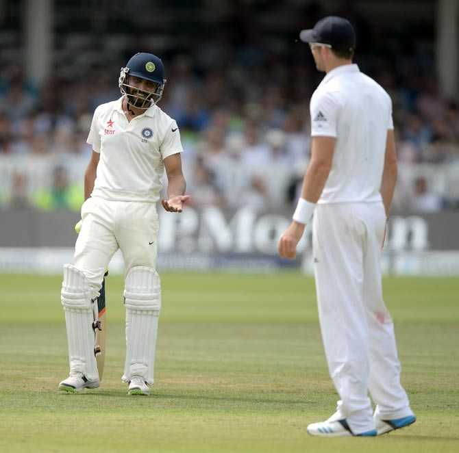 Ravindra Jadeja (left) speaks with James Anderson during the second Test at Lord's in London