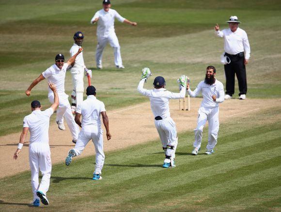Moeen Ali celebrates a wicket