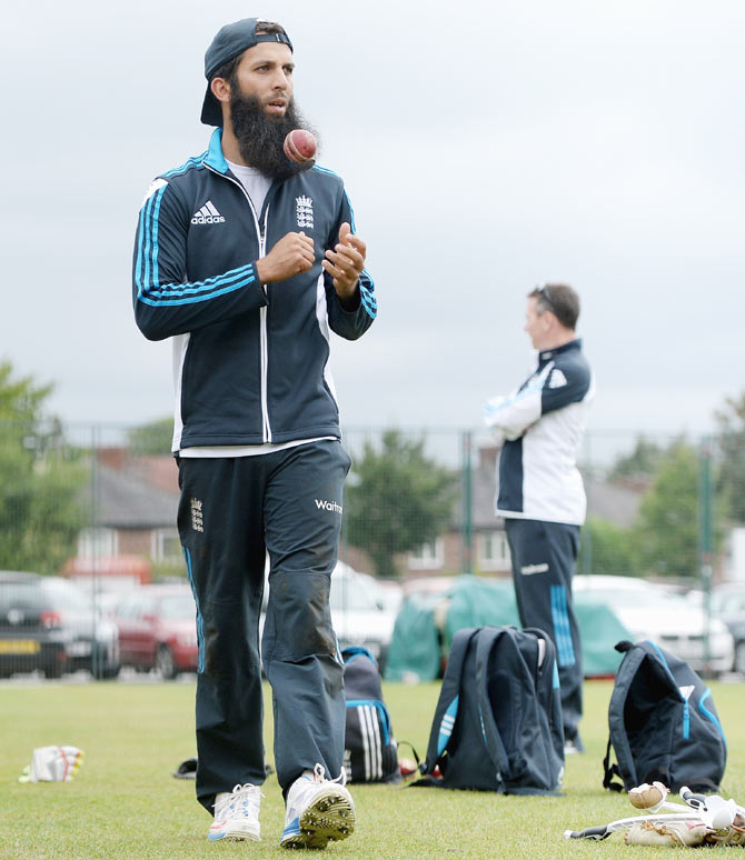 Moeen Ali of England prepares bowl during a nets session