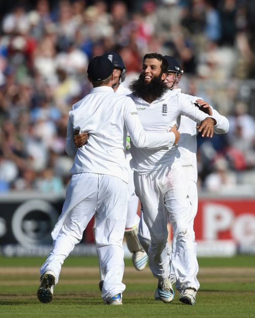Moeen Ali celebrates a wicket with his England teammates