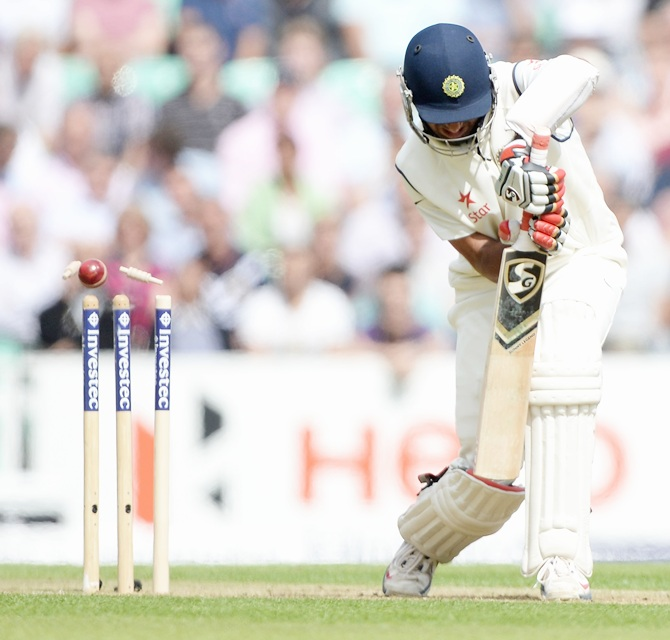 heteshwar Pujara of India is bowled by Stuart Broad