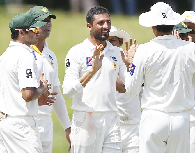 Pakistan's Junaid Khan, centre, celebrates with team mates after taking the wicket of Sri Lanka's Dhammika Prasad (not pictured)