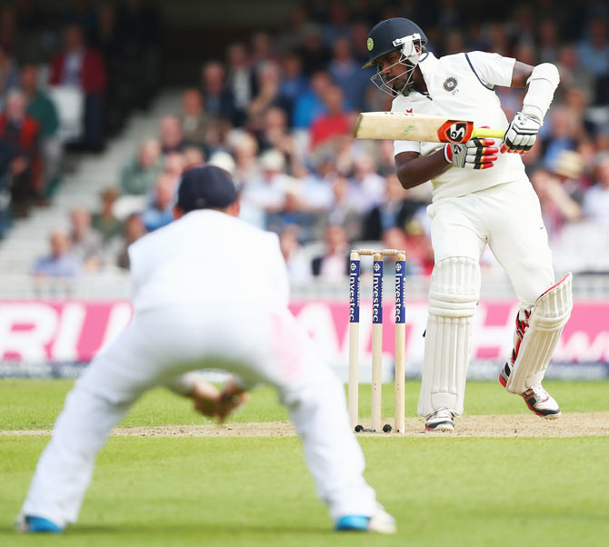 Varun Aaron of India is hit by a rising delivery on Friday