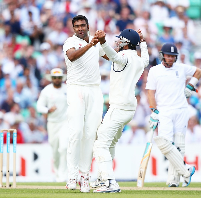 Ravichandran Ashwin of India celebrates with his team-mates after taking the wicket of Gary Ballance of England