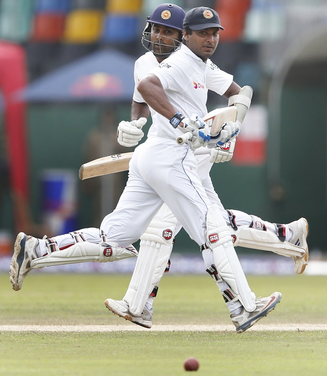 Sri Lanka's Mahela Jayawardene, left, and Kumar Sangakkara celebrate their partnership