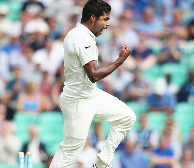 Varun Aaron celebrates after dismissing Sam Robson