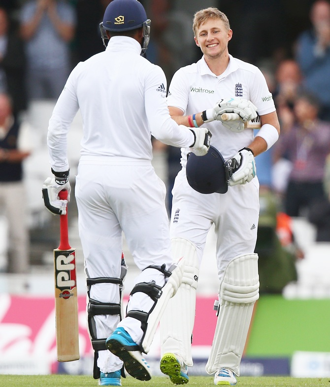 Joe Root of England celebrates with Chris Jordan after making a century