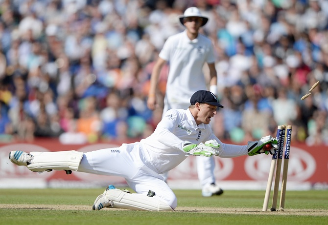Jos Buttler of England runs out Varun Aaron of India