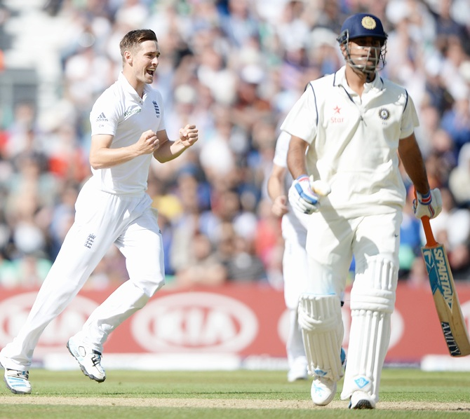 Chris Woakes of England celebrates dismissing Mahendra Singh Dhoni