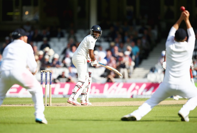Ravichandran Ashwin of India looks back as Gary Ballance of England parries the ball   before Ian Bell catches him out for 7 runs of the bowling of Chris Jordan