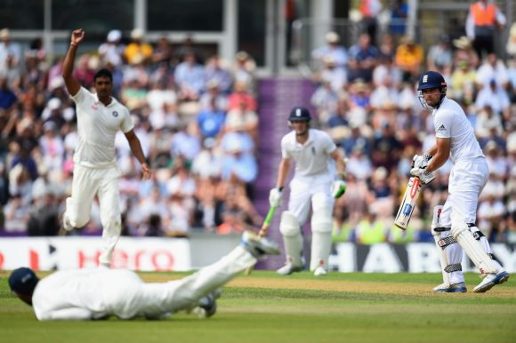 Captain Alastair Cook of England looks back as he tips the ball towards Ravindra Jadeja of India who drops the catch