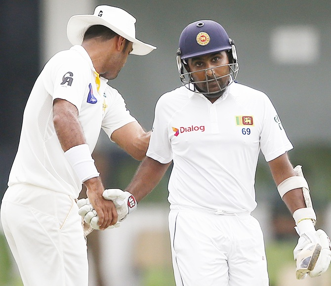 Pakistan's Wahab Riaz shares a moment with Sri Lanka's   Mahela Jaywardene as Jayawardene walks off the field after the dismissal