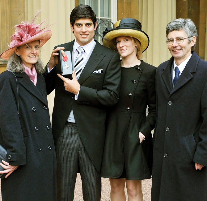 England cricketer Alastair Cook stands with his wife Alice Hunt,second right, and parents Stephanie and Graham as he displays his   Member of the Most Excellent Order of the British Empire (MBE) medal