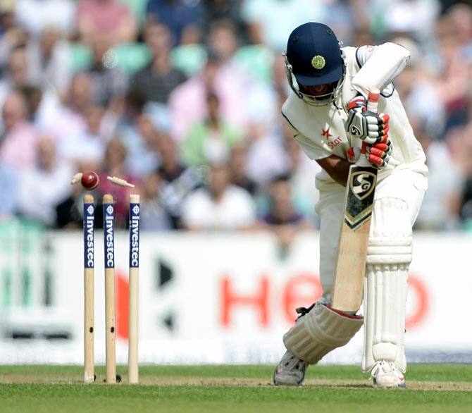 Cheteshwar Pujara of India is bowled by Stuart Broad