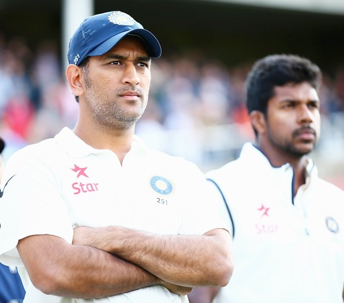 India captain Mahendra Singh Dhoni, left and Varun Aaron after India lost the series.