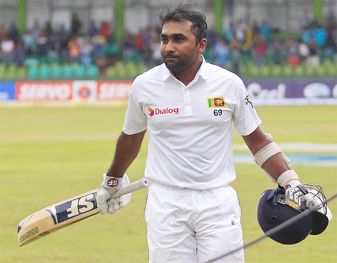 Sri Lanka's Mahela Jaywardene walks off the field after his dismissal during the fourth day of their second and final Test match against Pakistan in Colombo on Sunday