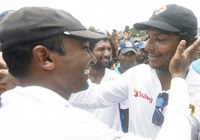 Sri Lanka's Kumar Sangakkara, right, wishes his long time batting partner Mahela Jayawardene