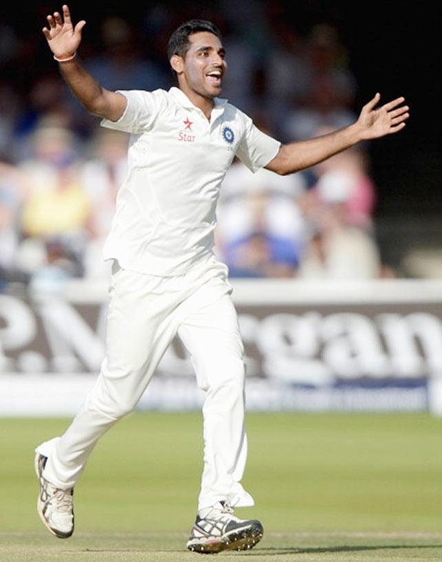 Bhuvneshwar Kumar celebrates dismissing England batsman Gary Ballance at Lord's