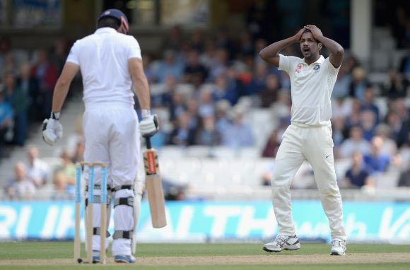 Varun Aaron of India reacts after bowling to England captain Alastair Cook
