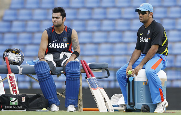 India's captain Mahendra Singh Dhoni, right, and Virat Kohli look on during a practice session