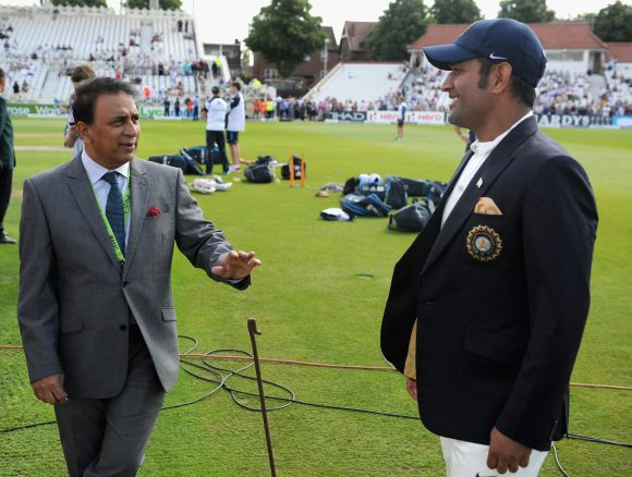Sunil Gavaskar, left, and Mahendra Singh Dhoni
