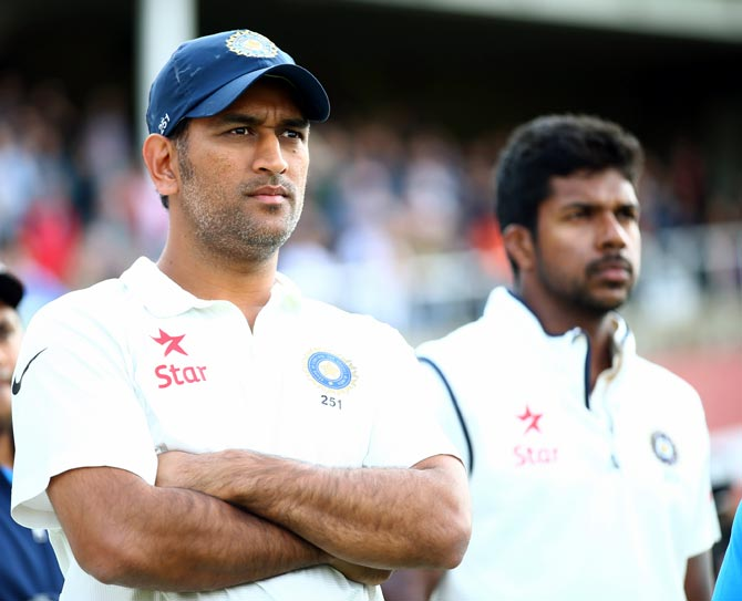 Mahendra Singh Dhoni and pacer Varun Aaron look on after India lost the fifth Test at The Oval