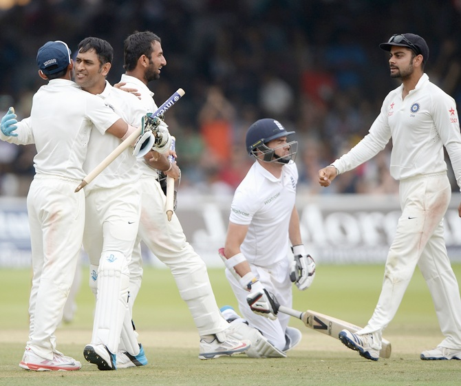 India celebrate running out James Anderson of England to win the 2nd Investec Test match at Lord's