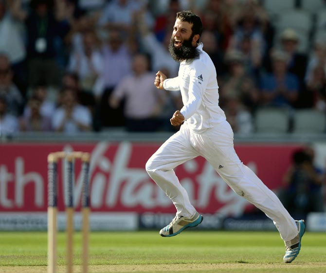 Moeen Ali of England celebrates dismissing Mahendra Singh Dhoni of India during the fourth Test match in Manchester