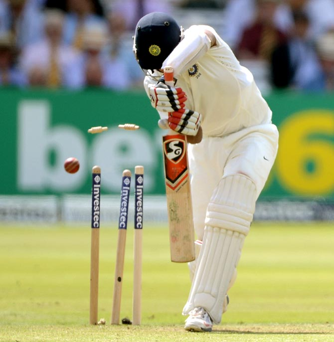 Cheteshwar Pujara is bowled by Ben Stokes of England during the second Test