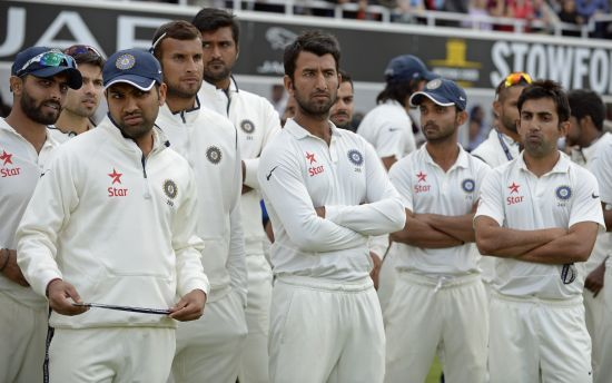 Indian players wear a dejected look after the fifth Test in England