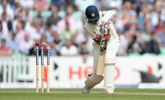 Cheteshwar Pujara is clean bowled by Stuart Broad