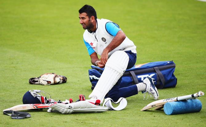 Cheteshwar Pujara prepares to bat in the nets.