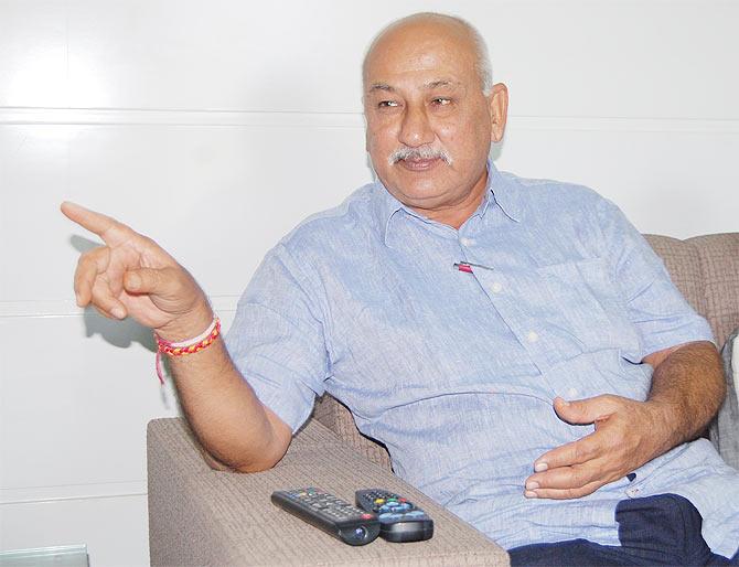 Arvind Pujara, Cheteshwar Pujara's father.