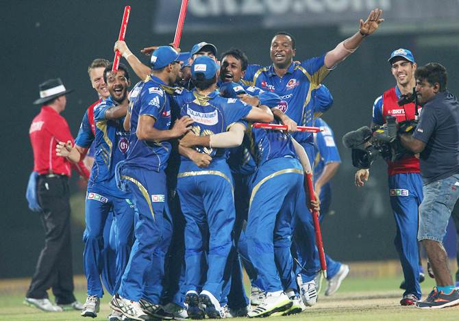 Mumbai Indians players celebrate after beating Rajasthan Royals in the final of the 2013 Champions League T20