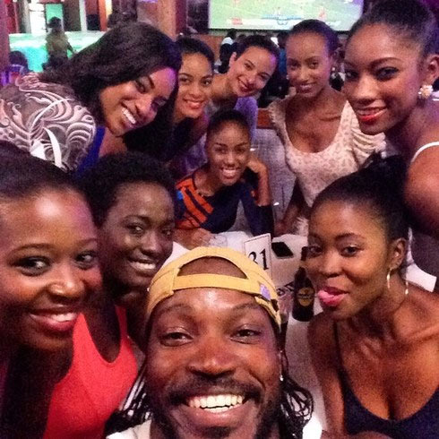 Chris Gayle takes a selfie with a roomful of his admirers