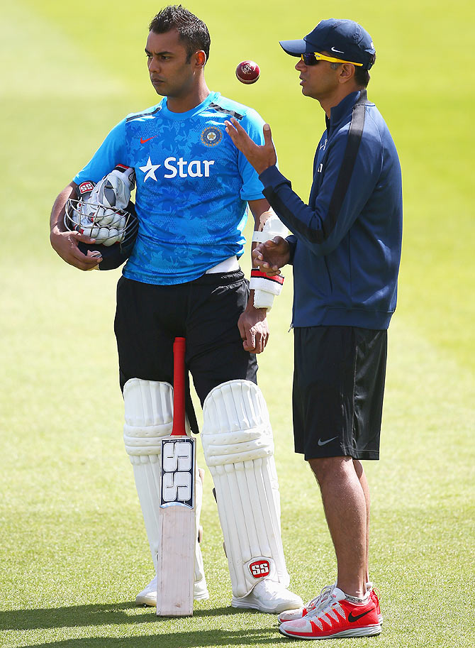 Stuart Binny of India talks to Rahul Dravid during a India nets session