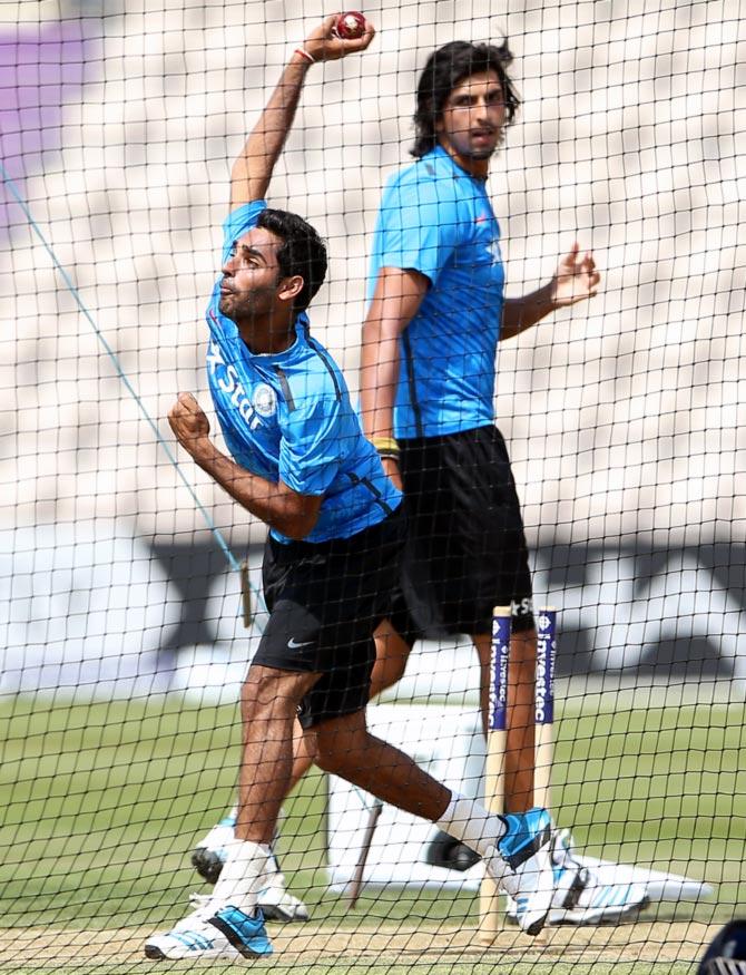 Bhuvneshwar Kumar (left) bowls in the nets as team mate Ishant Sharma looks on