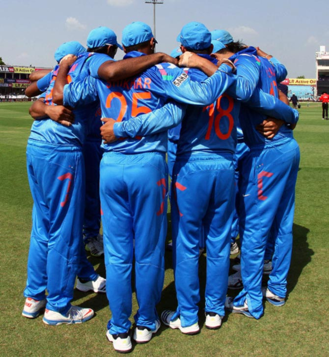 Team India in a huddle