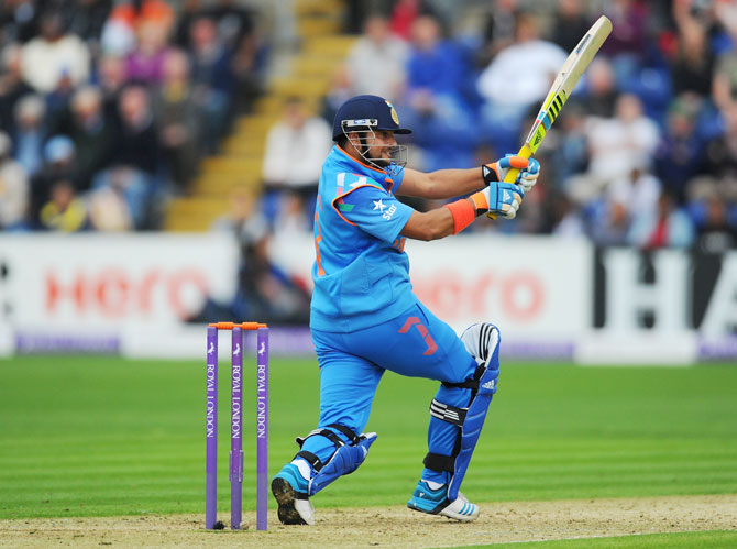 Suresh Raina hit a century (off 75 balls) to ensure India won the ODI against England in Cardiff, August 27, 2014. Photograph: Stu Forster/Getty Images