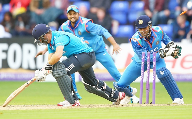 Chris Woakes of England is stumped by MS Dhoni of India