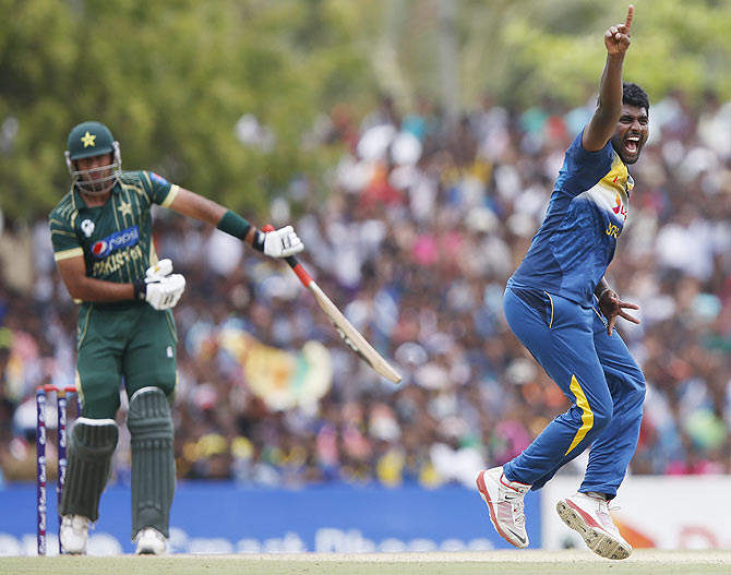 Sri Lanka's Thisara Perera (right) appeals successfully for the wicket of Pakistan's Wahab Riaz during their final ODI (One Day International) in Dambulla on Saturday