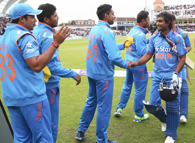 Ambati Rayudu, right, of India is congratulated by team mates