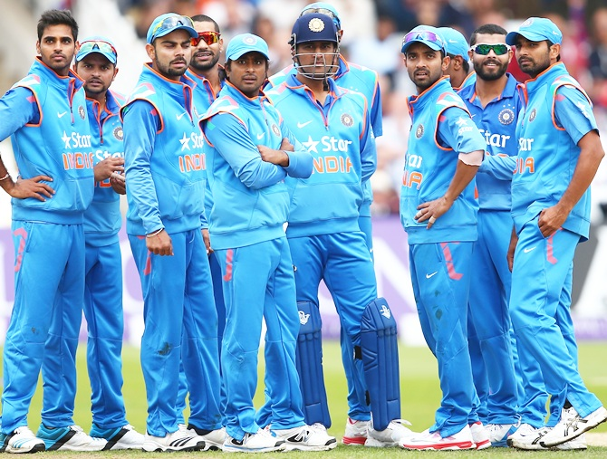 The Indian team wait for a review decision