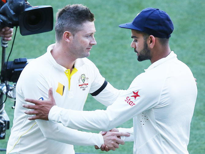 Michael Clarke greets Virat Kohli after the first Test on Saturday