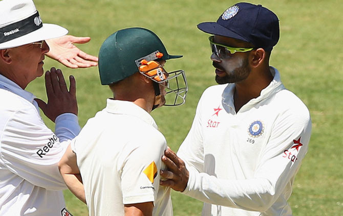 India captain Virat Kohli speaks to David Warner