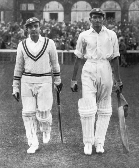 Syed Mushtaq Ali, right, and Vijay Merchant walk out to bat on Day 1 of the Test against England at Old Trafford, July 25, 1936. Photograph: Keystone/Hulton Archive/Getty Images