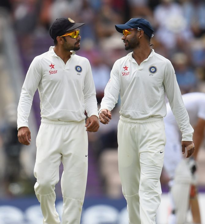 Rediff Sports - Cricket, Indian hockey, Tennis, Football, Chess, Golf - Dhoni rubbishes reports of Kohli-Dhawan spat